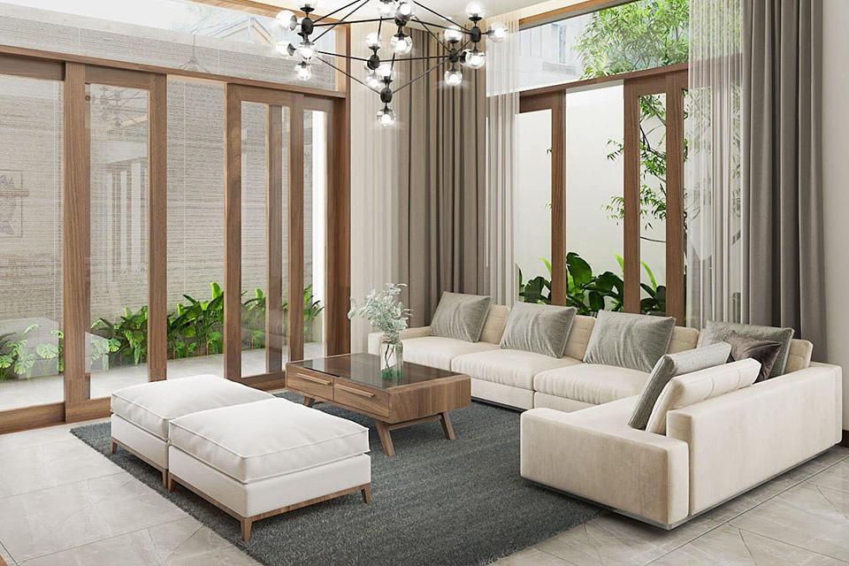 Nội thất phòng khách biệt thự bài trí đơn giản để tạo không gian thông thoáng